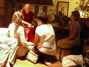 Anila chatting on Tibetan Buddhism with yogis in Bangkok